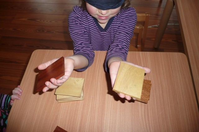 Child holding pieces of wood